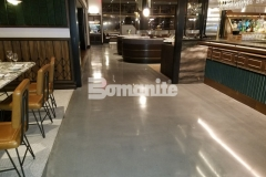 With Michael Symon's ode to classic Italian food at his restaurant, Angeline, the design needed to reflect a balance of old and new world style and the custom coloring and satin finish of this Bomanite Modena SL polished concrete flooring is a beautiful blend of both styles and offers sophistication and durability.