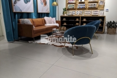 This Bomanite Modena SL custom polished concrete overlay features a warm gray tone and beautiful satin finish and was perfect to provide the Nickel & Suede flagship store with a low maintenance surface that enhances the design detail throughout.