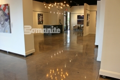 Patene Teres custom polished concrete by Bomanite is featured here and this high gloss surface adds a warm, radiant design aesthetic to highlight the memorial portraiture that was created as part of The American Fallen Soldiers Project.