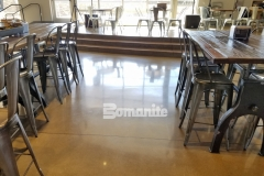 The Bomanite Patene Teres Custom Polishing System was used here to create a beautiful sheen on the decorative concrete flooring inside the Northside Christian School and Frappe House at CrossCity Christian Church, and the finished product perfectly complements the contemporary design of the space while providing a beautiful and durable flooring surface.