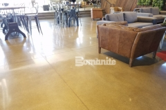 Patene Teres by Bomanite was used here to create a high polished decorative concrete flooring in this coffee shop, establishing cohesiveness throughout the space and matching the beautiful sophistication and contemporary aesthetic.