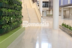 This high-end, customized decorative concrete surface was created using the Bomanite Renaissance Deep Grind System, which involves treating the floor with chemical hardeners that reduce porosity while still allowing it to breath, which makes the fully exposed hard aggregates the predominate wear surface and allows the floor to wear naturally while supporting superior stain resistance.