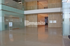Bomanite VitraFlor custom polished concrete was installed here with a 1,500-grit polish and salt and pepper finish to enhance the beautiful warmth and elegance of the modern architecture at the Cypress Waters Business Complex.