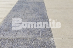 Featured here is Bomanite Revealed with the addition of light and dark blue glass, black granite aggregate, and Bomanite Seal Gray Integral Color and the non-skid properties and abrasion resistant aggregates that this new sidewalk and accessible driveway offer, make it the perfect choice for this space at Valley Children's Hospital.