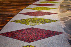Our colleague Bomanite of Tulsa, Inc. earned the Best Bomanite Exposed Aggregate Systems Project Gold Award for their installation of Bomanite Revealed with white, red, yellow, and black glass aggregates inside the Choctaw Cultural Center and Museum, creating a pattern significant to the Choctaw Nation and providing an exposed look that complements the rustic flooring materials that lay adjacent to this application.