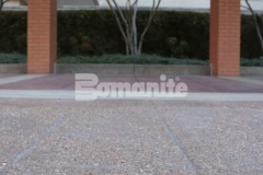 The Residence Condominiums ownership enlisted Musselman & Hall Contractors to replace their aging pavement at the front entrance and utilized Bomanite Bomacron English Sidewalk Slate imprinted concrete with a Bomanite Sandscape Texture Exposed Aggregate finish to create a decorative and durable hardscape surface that will not show wear from traffic or need constant resealing to look fresh.