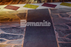 Bomanite Revealed and Bomanite Sandscape Texture were both installed inside the Choctaw Cultural Center to create the interior entrance flooring and add textural variation and distinct design detail between the hardwood and stone flooring surfaces.