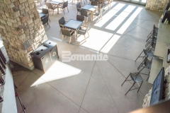 The hardscape surfaces at Gaylord Rockies Resort & Convention Center include Bomanite Exposed Aggregate Sandscape Texture decorative concrete and this product was an ideal choice to create a durable surface while creating unity between the interior flooring and exterior hardscapes of this Colorado resort.