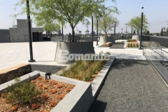 Our associate, Bomel Construction Company, skillfully installed a gray Bomanite Exposed Aggregate Sandscape Texture finish on these lineal planters and circular tree planters, adding textural detail that complements the geometrical arrangement of the pedestal pavers on this rooftop terrace and garden.