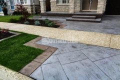 We installed this Bomanite Yorkshire Stone imprinted concrete driveway and patio with Bomanite Shale Gray Color Hardener and a Gray Release Agent to create a beautiful combination that integrates perfectly with the existing concrete walkway while adding distinctive design detail that enhances the home's architecture.