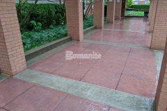The main entrance of the Residence Condominiums showcases Bomanite Bomacron Slate Texture imprinted concrete with the addition of Bomanite Cafe Au Lait Integral Color for the sidewalk bands and Bomanite Franciscan Red Color Hardener for the main expanse of the walkway, a combination that corresponds perfectly with the existing brick exterior colors and provides a stylish transition.