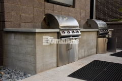 This imprinted outdoor kitchen grill at COLAB Co-Housing was created with board-formed concrete, which is the process of patterning concrete that leaves a wood grain image on the finished face, and was perfect to provide a place to enjoy a neighborhood cookout in this stylish living community.