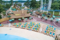 Bomanite Imprint Systems were installed here by Harrington Bomanite to create 45,000 SF of stamped concrete, using multiple patterns and colors to add variation in texture and a distinctive design aesthetic, while providing a durable decking solution around this new water feature at Canobie Lake Park.