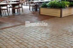 The Bomanite Belgium Block imprint pattern was used here to create a stamped concrete hardscape and required rigorous placement precision to achieve an intentionally consistent look and the finished product integrates perfectly into the natural design aesthetic at the Gaylord Rockies Resort & Convention Center.