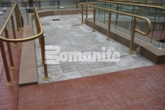 The Bomanite Medium Ashlar Slate Bomacron pattern was used here to create a stamped concrete pedestrian bridge and wheelchair access ramps and this durable surface features a stunning design that balances perfectly in this space.