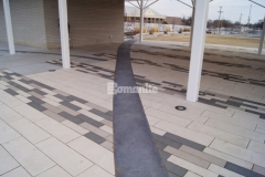 Showcased here is the Bomanite Sandstone pattern that was used to create imprinted concrete accent borders, adding definition around the concrete pavers in this pavilion area and enhancing the overall design aesthetic at Redbud Festival Park in Owasso, Oklahoma.