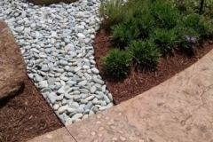 Bomanite Imprinted Concrete was installed here using the Bomacron Regular Slate pattern and the texture, color, and strategically placed stones and pebbles that were added to this hardscape walkway combine perfectly to create a beautiful, tranquil setting in this healing garden.