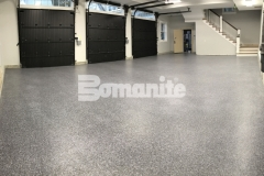 Our colleague, Premier Concrete Construction, utilized the Bomanite Broadcast Flake Toppings System to correct a badly poured concrete garage foundation and this protective flooring surface will stand up to long term wear and tear.