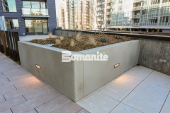 Bomanite Micro-Top ST is a specialized decorative concrete that can cover virtually any surface and was applied here as an overlay to create planter boxes that are durable and versatile enough to withstand weather while providing a sand-finished texture with beautiful coloration.