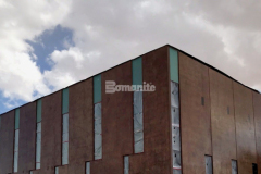 A semi-weathered, antiquing effect was created on the vertical concrete panels that make up the exterior of the Beast Urban Park recreational facility in El Paso, TX by applying Bomanite Paténe Artectura acid-based stain and an acrylic sealant, which ensured that the treatment is long-lasting and will stand up to the arid El Paso climate.
