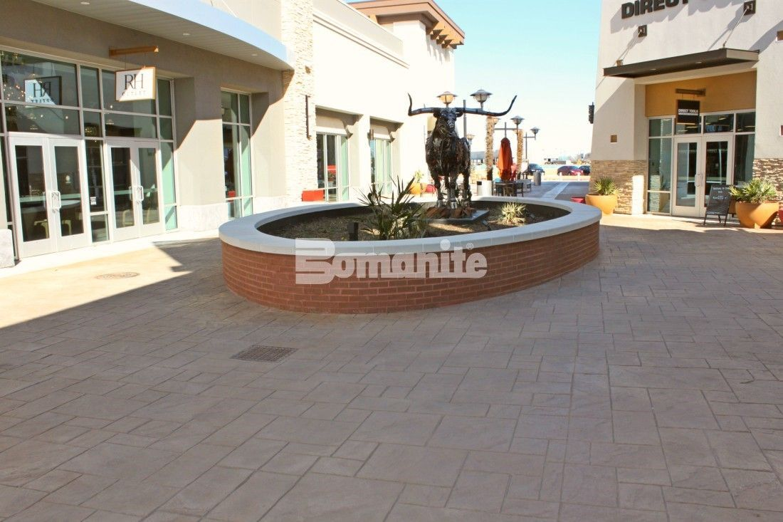 Texas Longhorn prominently featured in a planter at the Tanger Outlets Fort Worth Location with Texas Themed Walkways Using Bomanite Imprint Systems throughout the hi-end shopping center installed by Texas Bomanite with design by Adams & Associates.