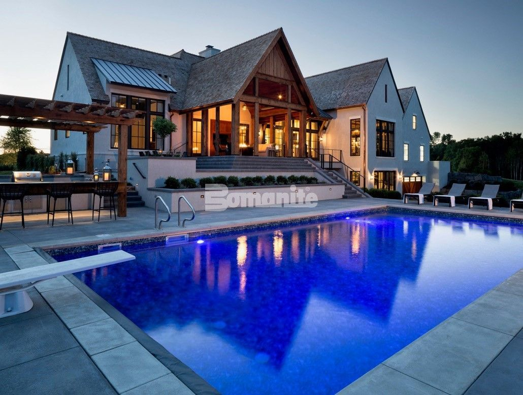Luxury Home Builder, Hendel Homes, chose Bomanite Licensee Concrete Arts for the spacious pool deck installation for their clients modern Tudor style new home, using Bomanite Sandscape Refined Antico Exposed Aggregate which provides them with the sophistication and safety desired.